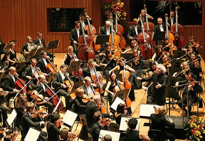 Sir Simon Rattle conducts The Australian World in Orchestra in 2015 Photo: Prudence Upton