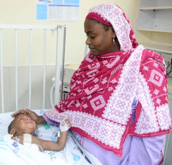 A patient from Zanzibar with his mother