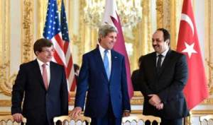 On July 26, 2014, (from left to right) Turkish Foreign Minister Ahmet Davutoğlu, U.S. Secretary of State John Kerry, and Qatari Foreign Minister Khalid bin Mohammad Al Attiyah hold a trilateral meeting in Paris focused on reaching a cease-fire deal for the Gaza conflict. JNS.org columnist Ben Cohen asks: Should we continue ignoring Qatari and Turkish backing of Hamas for the sake of a successful campaign against Islamic State? Credit: U.S. State Department.