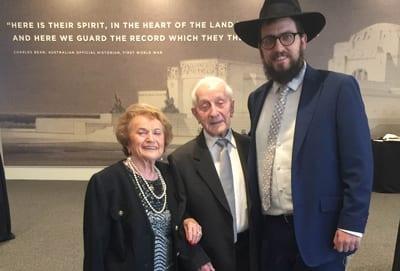 Survivors Cesia and Abe Goldberg with ACT Chabad Rabbi Shmueli Feldman