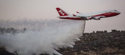 On Nov. 26, the American-dispatched Boeing 747 Supertanker plane helps extinguish a forest fire that broke out in Nataf, near Jerusalem. Credit: Hadas Parush/Flash90.