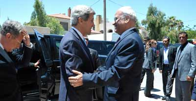 U.S. Secretary of State John Kerry is greeted by Saeb Erekat, chief negotiator for the Palestinian Authority in the eventually collapsed American-brokered Israel-Palestinian peace talks, before a meeting in Amman, Jordan, on June 28, 2013.