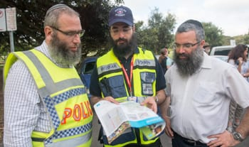 Police chaplain Rabbi Mendel Kastel, Rabbi Yehuda Niasoff and Rabbi Dov Slavin