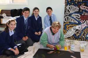 Barbara Weir shows Moriah students the finer points of Aboriginal art