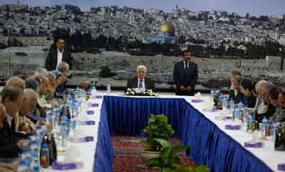 Palestinian Authority President Mahmud Abbas (center) speaks during an emergency meeting with his leadership in Ramallah on July 1, 2014, after Israel found the dead bodies of the three kidnapped Jewish teens. Credit: Issam Rimawi/Flash90.