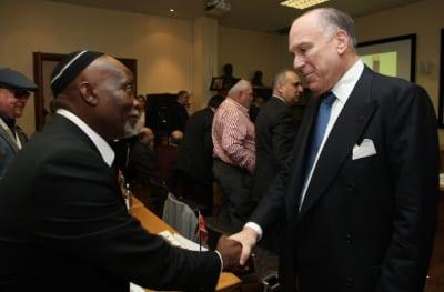 Geoff Ramokgadi, head of the Jewish community of Swaziland greets Ronald S. Lauder