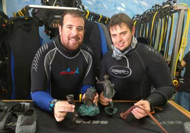 Ran Feinstein (right) and Ofer Ra'anan after the discovery. Photographic credit: The Old Caesarea Diving Center