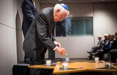 95-yr-old Auschwitz survivor Eddie Jaku lights a memorial candle