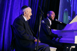 1.Amazing entertainers: Resident and tenor Moishe Fried accompanied on piano by cantor Dov Farkas.