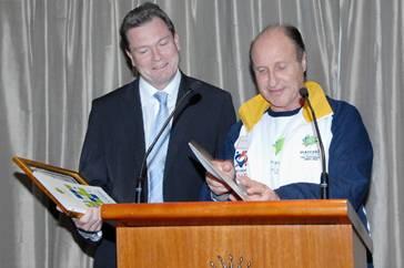 Tom Goldman makes a presentation to Premier Nathan Rees