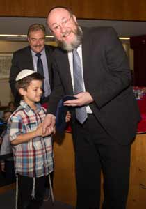 Year K's Sam Kramer received his first Tallit from the Chief Rabbi