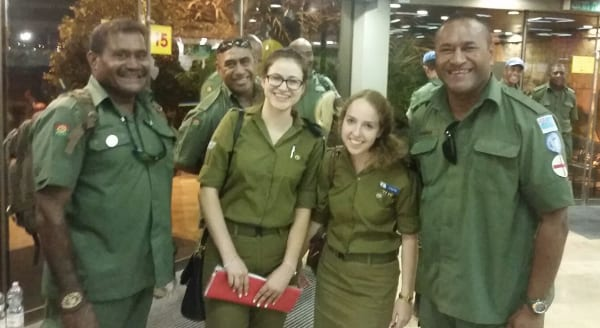 Shir Eshed [left] with Judy Feld Carr's granddaughter Aliza accompanying U.S. soldiers from Fiji in Israel