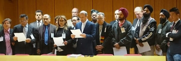 Keep NSW Safe spokesperson and NSW Jewish Board of Deputies CEO Vic Alhadeff (centre) reads a statement calling on the State Government to overhaul the race-hate law to make it effective. He is flanked by members of the 20 organisations which signed the statement.