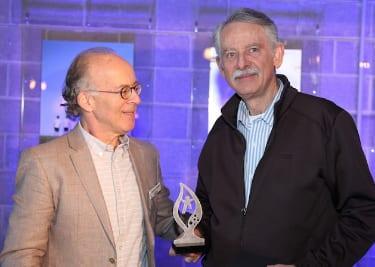 JCA president Stephen Chipkin presents the award to Wold Polack