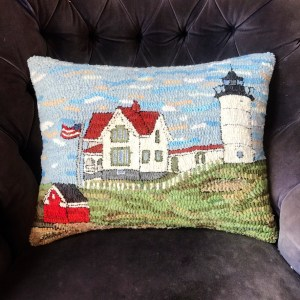 Nubble Lighthouse Hooked Rug styled as a pillow.