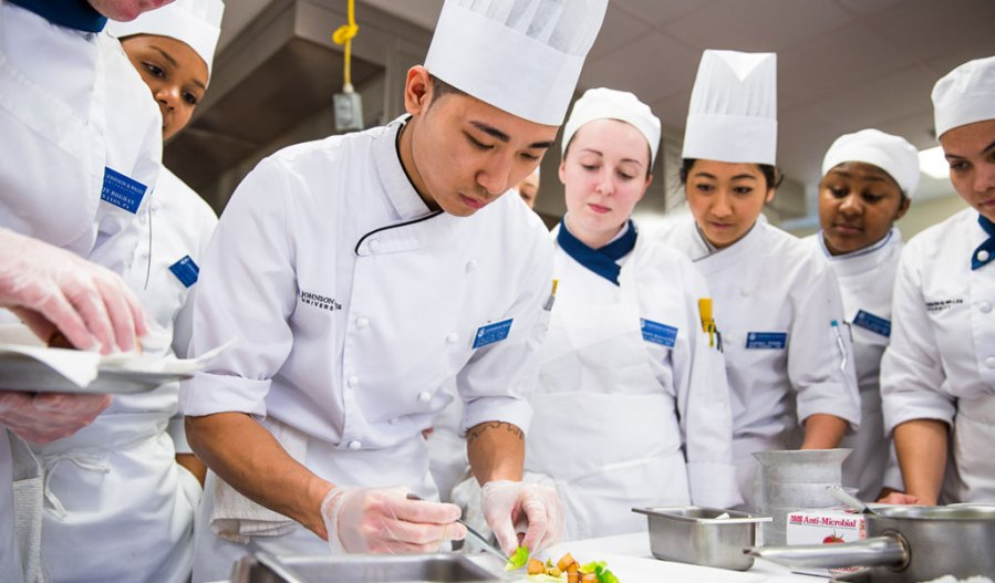 College of Culinary Arts   Johnson   Wales University group of chefs in kitchen