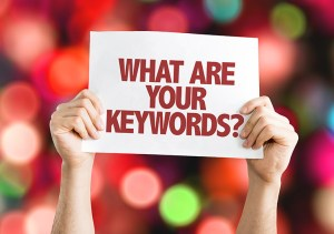 What are your keywords sign with colored lights in background