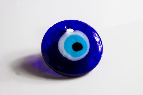 A blue glass disc, with concentric rings of white, then light blue, than black, which look like an eye