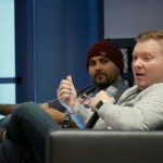 Chris Teitzel sitting on a couch with Tony Perez during a panel at LoopConf 2018