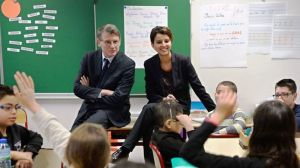 "French Education Minister Vincent Peillon (L) and French Minister for Women's Rights and Government Spokesperson Najat Vallaud-Belkacem (R) speak with pupils about egality between boys and girls during a visit to a primary school on the theme ""The ABCD of equality"" on January 13, 2014, in Villeurbanne near Lyon, central-eastern France.  AFP PHOTO/PHILIPPE DESMAZES"