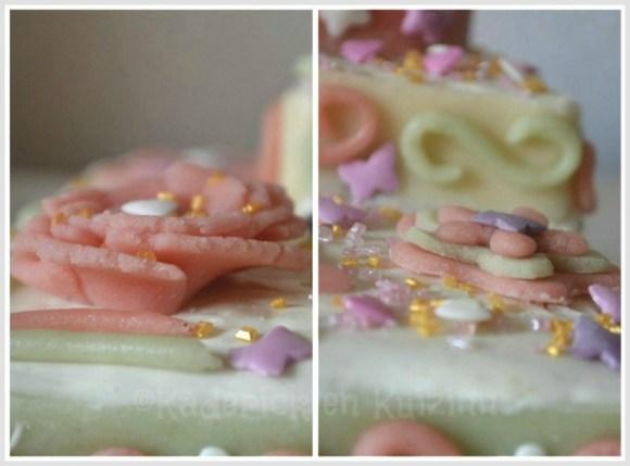 Détails de décoration du gateau de fête des mères décoré de fleur et de coeurs en pâte d'amande verte et rose