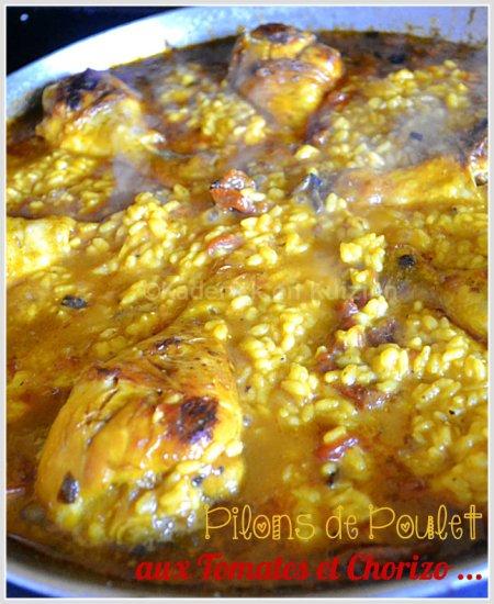 Dégustation pilons de poulet aux tomates et chorizo avec du riz safrané pour une cuisine espagnole