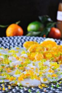 Noix st jacques carpaccio clémentines corses perles citron et vinaigre d'agrumes