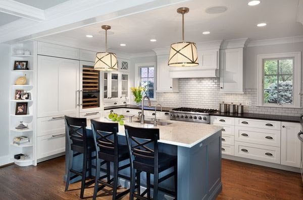 The kitchen island introduces a welcomed touch of color