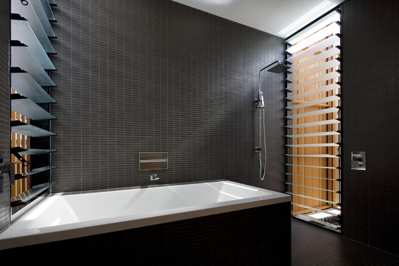 black and white bathroom is from a home in Sydney, Australia, designed by CplusC Architectural Workshop