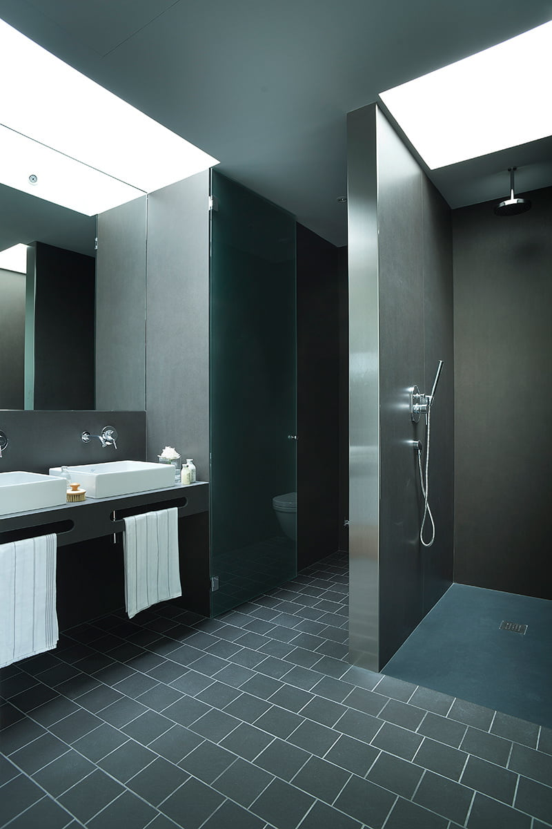 black and white bathroom is in a villa in Girona, Spain designed by Lagula Arquitectes
