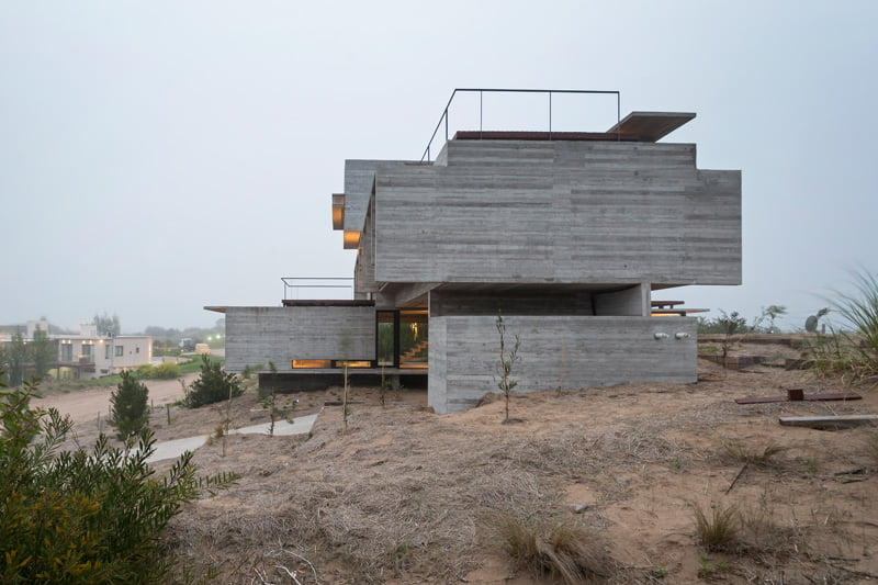 exposed concrete modern house side view