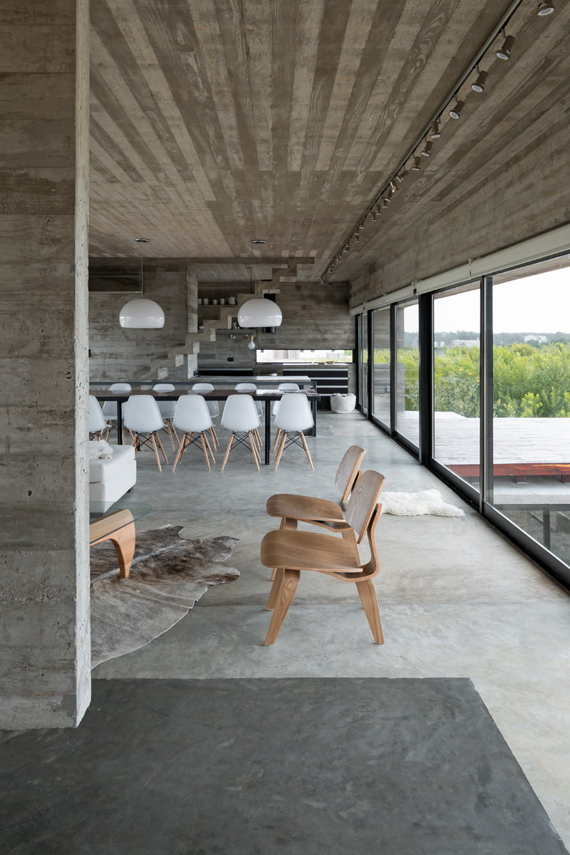 exposed concrete modern house with full height sliding window