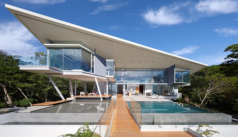 Angular Flat Sloping Roof Covered Modern House Create A Enjoyable View