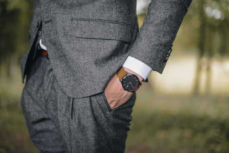 man wearing watch with hand on pocket