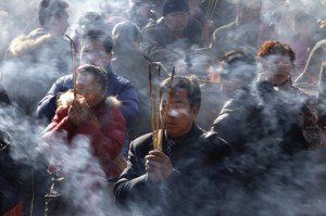 Beijing incense burning on Buddha's birthday at one of the temples. Photo: Jason Lee/Reuters via the WSJ