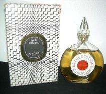 "Vintage Shalimar Eau de Cologne in the ""Watch"" or ""disk"" bottle next to its post-1967 ""Zebra"" box. Source: PicClick.com"