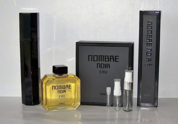 "The black, narrow, opaque EDP atomiser spray shown to the far left. Photo by eBay seller, ""gidgetpup5."""