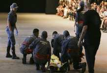Model Tales Soares is taken from the catwalk by paramedics after he collapsed during Sao Paulo Fashion Week in Sao Paulo, Brazil, Saturday, April 27, 2019.