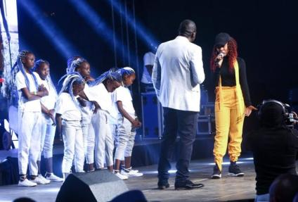 churchill_on_stage_with_moesha_kay_and_some_of_the_girls_she_supports