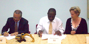 (from left) Jorge Medina, Professor Jacob Opadeyi, and UG Lecturer, Elena Trim during the signing of the MoU