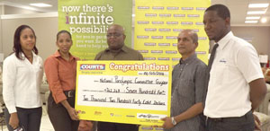 Marketing Director Molly Hassan (2nd left) presents the cheque to NPCG Treasurer Anand Mangru in the presence of from left, Marketing Officer Trudy Abrahams, Wilton Spencer and Marketing Manager Pernell Cummings.