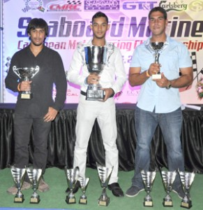 The kings of the Caribbean (from left)- Superbike champion Nikhil Seereeram, Group 4 and overall champion Kristian Jeffrey and Group 2 champion Mark Thompson pose for a photo op with their hardware..