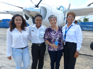 Female ASL pilots pose with Ms. Dawsey (second right) at ASL's Ogle hangar.