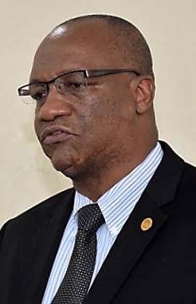 Embattled Minister Joseph Harmon