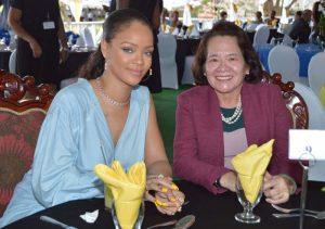 First Lady, Mrs. Sandra Granger, poses with pop star, Rihanna at Barbados' Toast to the Nation event Wednesday to celebrate that island's 50th anniversary celebrations.