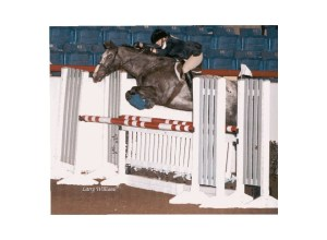 Michelle Anderson and her Appaloosa mare Snappy's Design winning the Appaloosa World Champion Non-Pro Jumper title in 1997. Photo by Larry Williams Photography.
