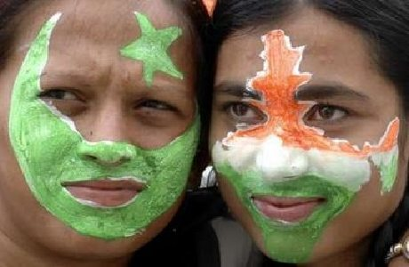 Girls show their faces painted in the colours of the Pakistani (L) and Indian national flags as part of Independence Day celebrations at a college in the western Indian city of Ahmedabad August 14, 2007.