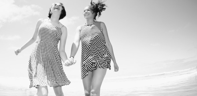 Black & Whitefish photo of two young girls laughing at the beach