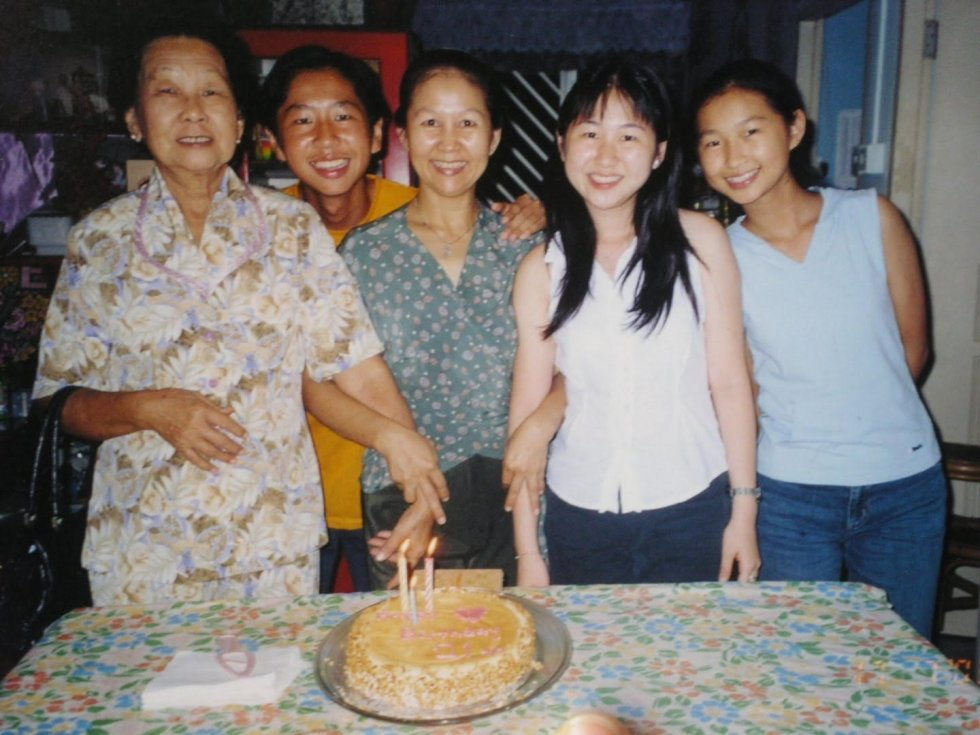 Jiamin (second from right), celebrating her 21st birthday with her family.