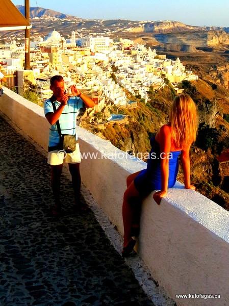 Tourists posing in Fira, Santorini